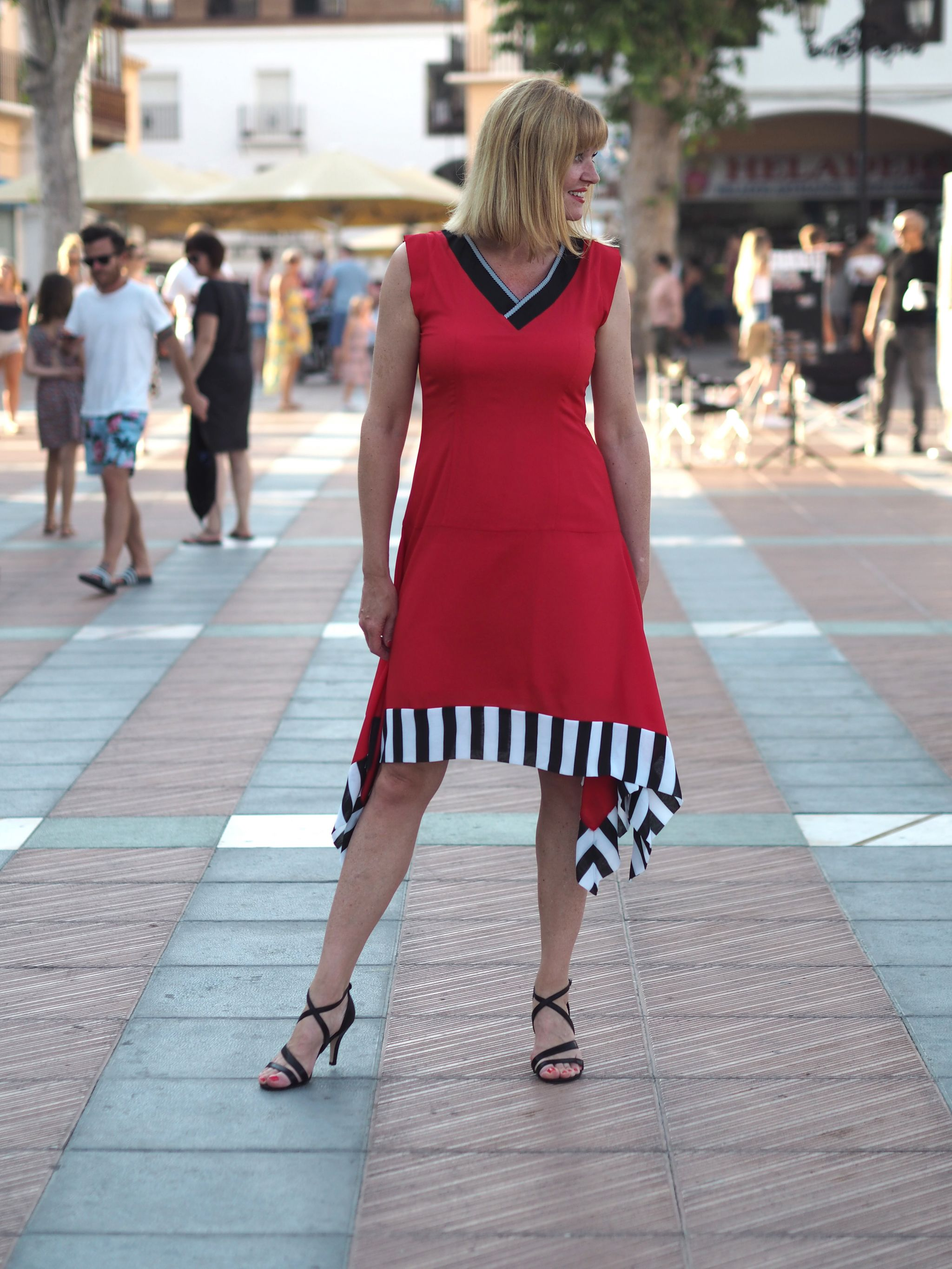 A Red Contrast Hem Dress And Shimmer Sandals For A Striking Summer Evening Look