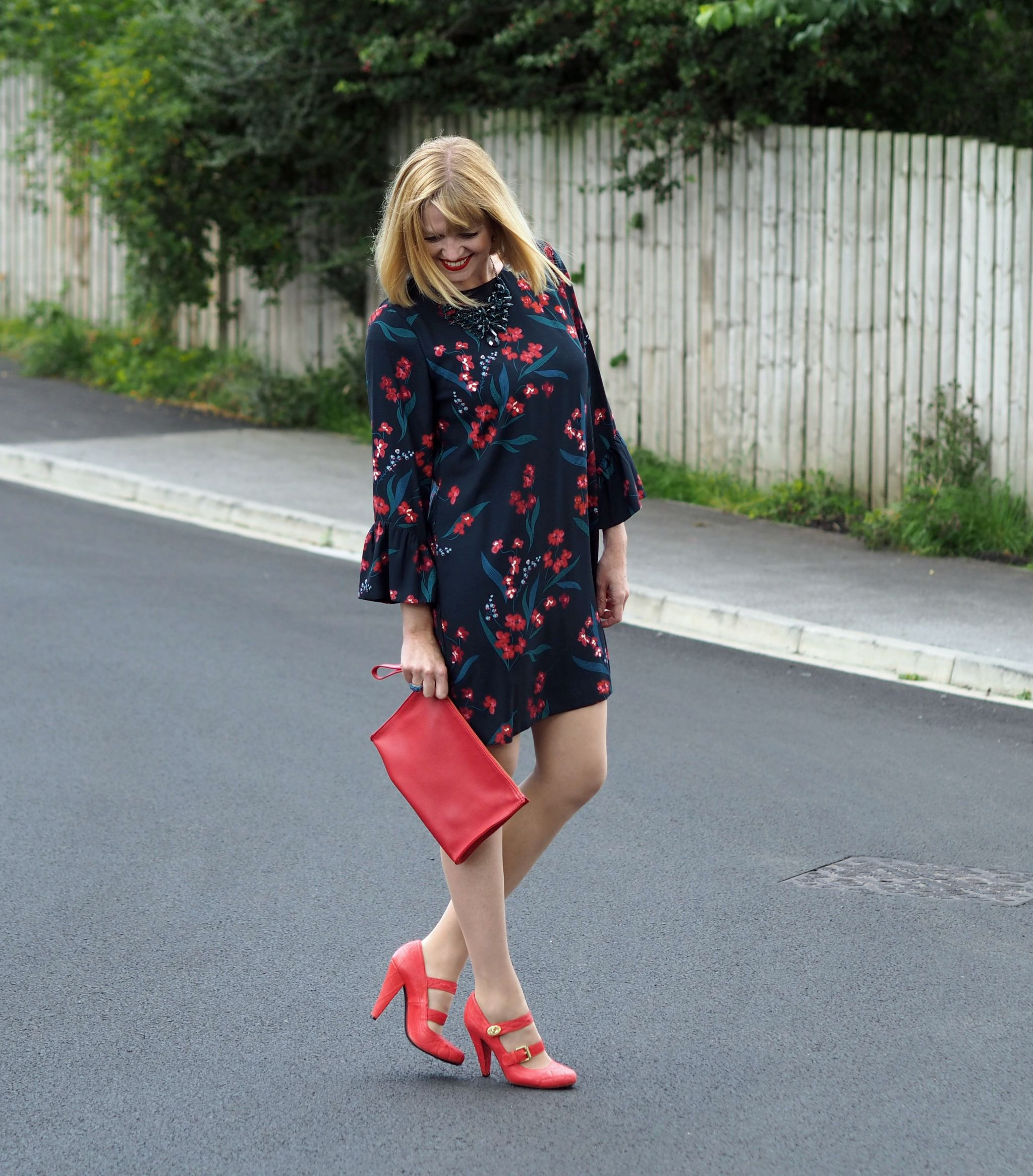 what-lizzy-loves-hobbs-desk-to-dinner-floral-dress-orange-shoes-side-view