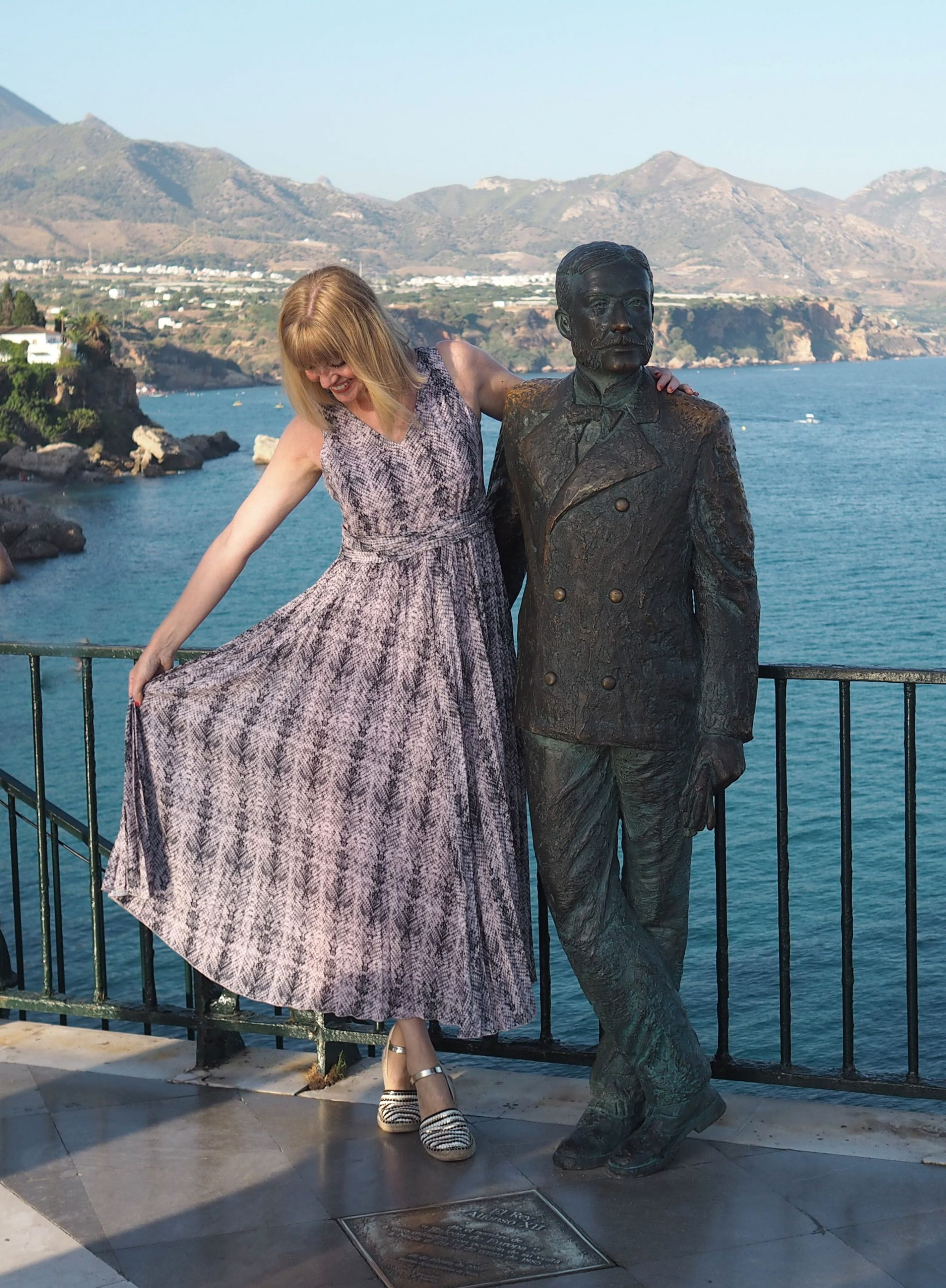 what-lizzyloves-holidayoutfits-pink-grey-snakeprint-maxi-dress-alfonso-statue-nerja