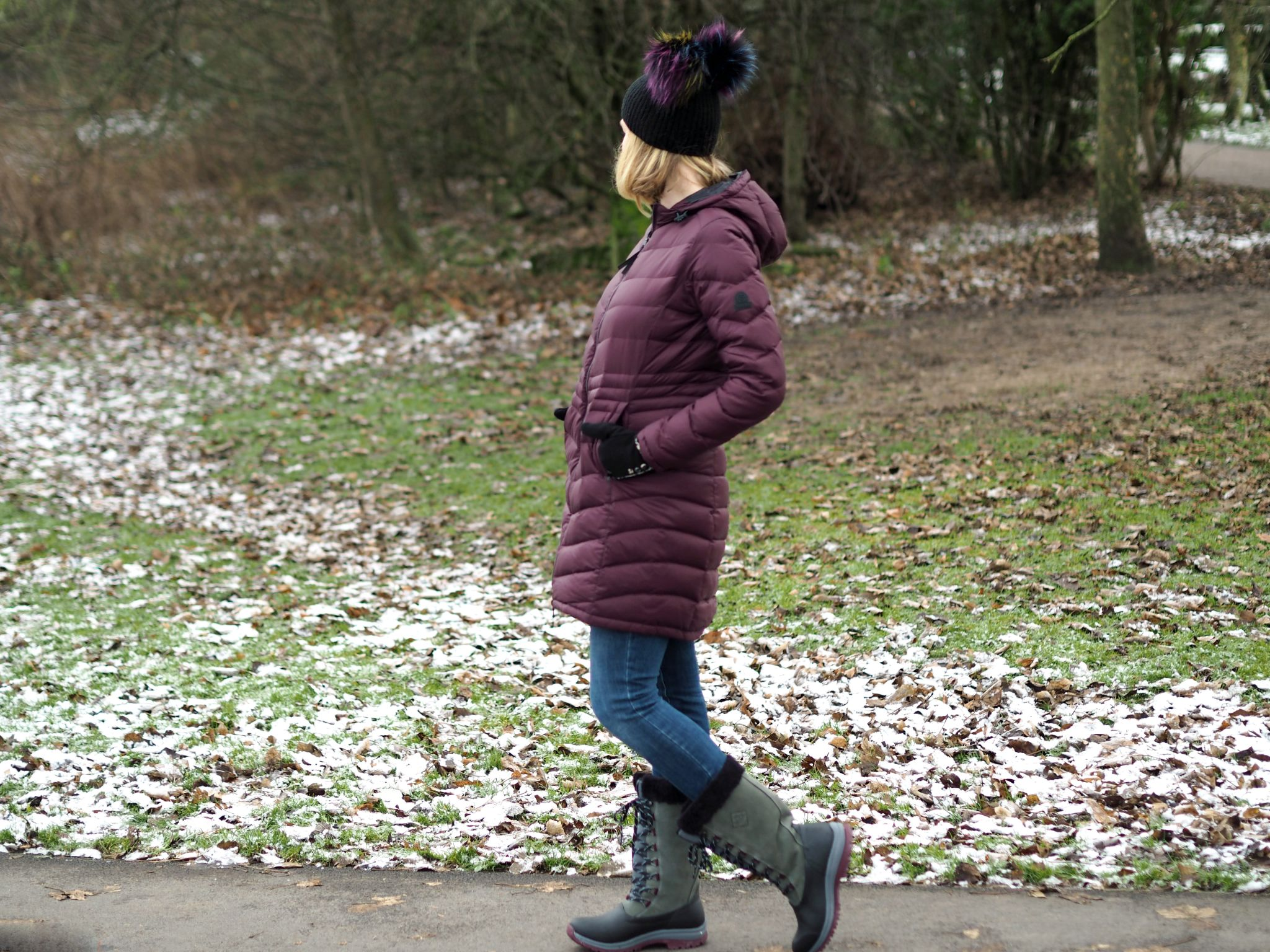 what lizzy loves keep warm look stylish flattering puffer coat pom pom hat