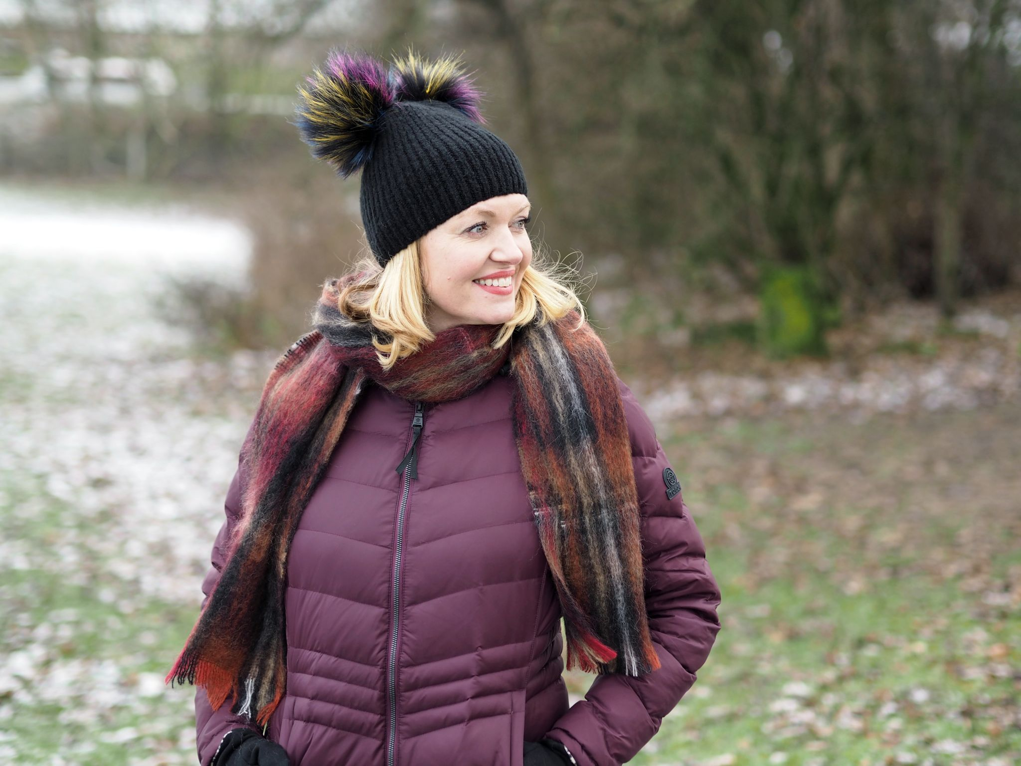 what lizzy loves keep warm look stylish flattering puffer coat double pom pom hat