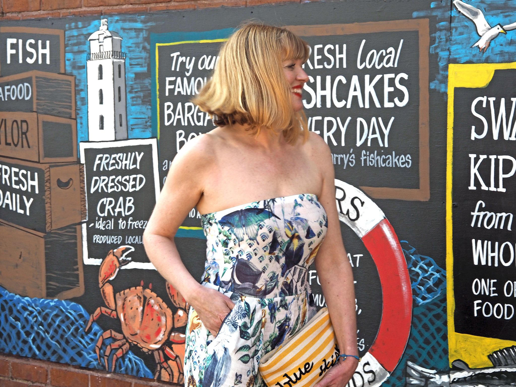 what lizzy loves strapless floral jumpsuit blue skies pouch north shields painted fish wall