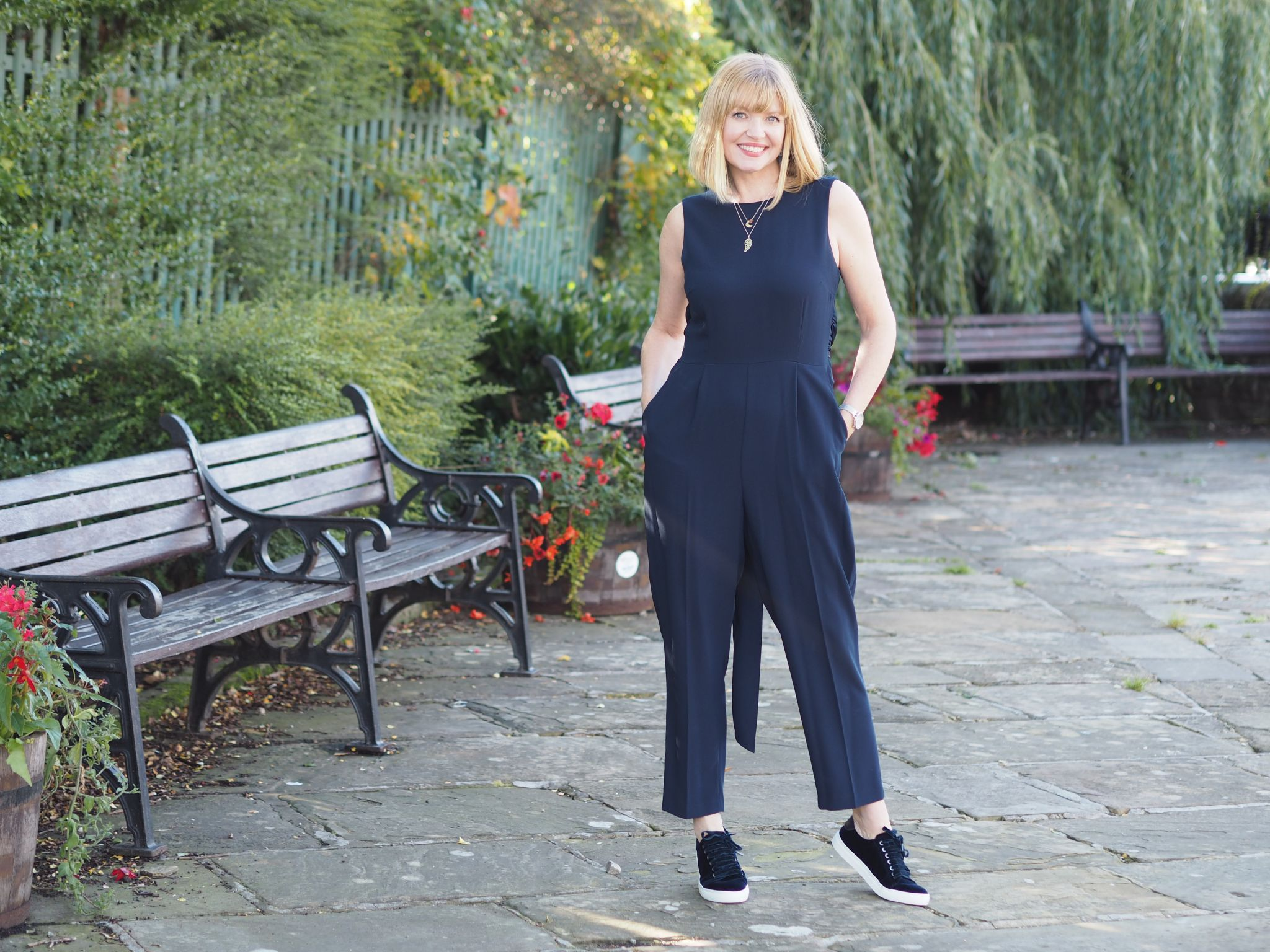 navy cropped sleeveless jumpsuit with navy trainers