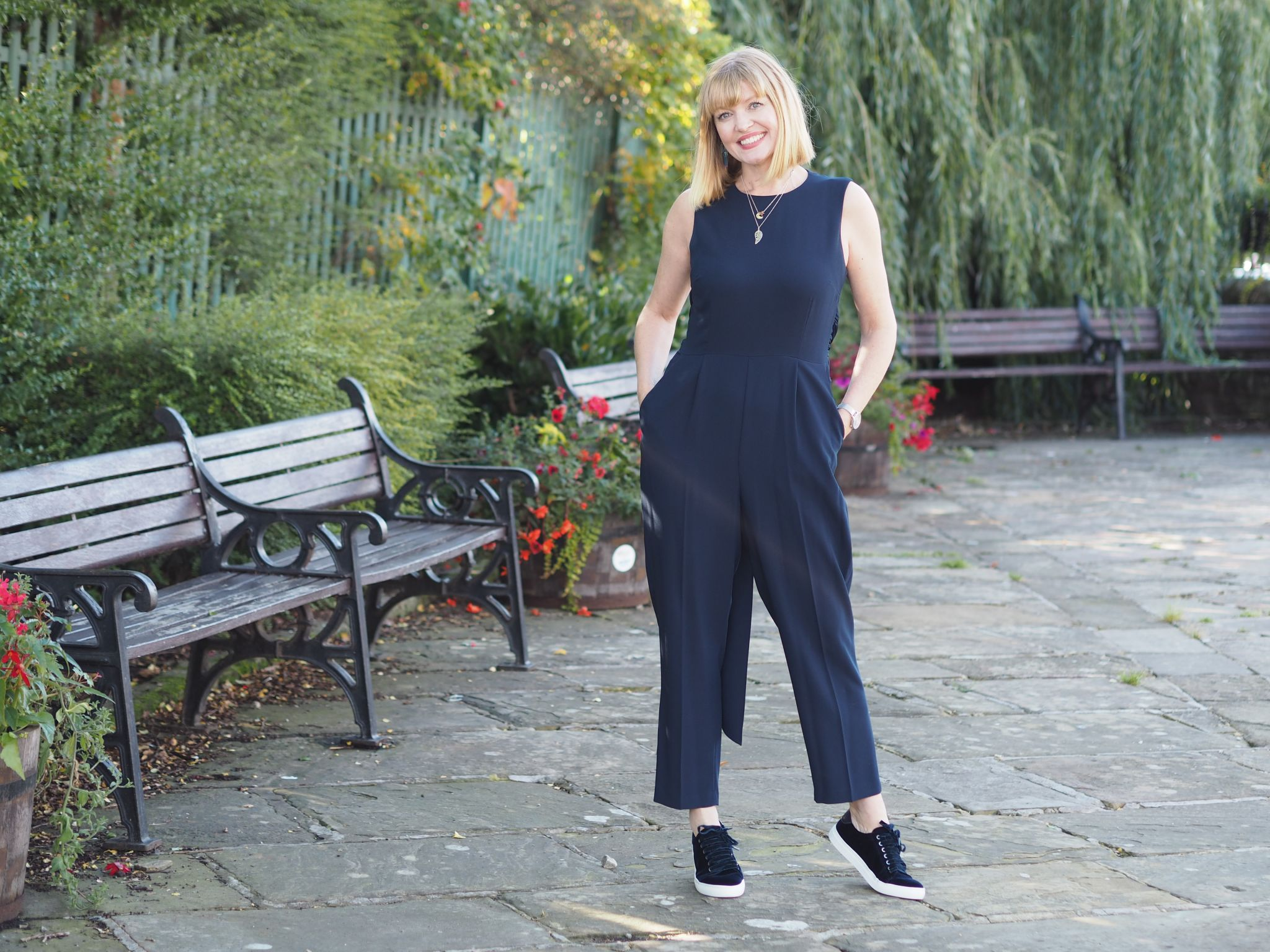 navy cropped sleeveless jumpsuit with navy velvet trainers