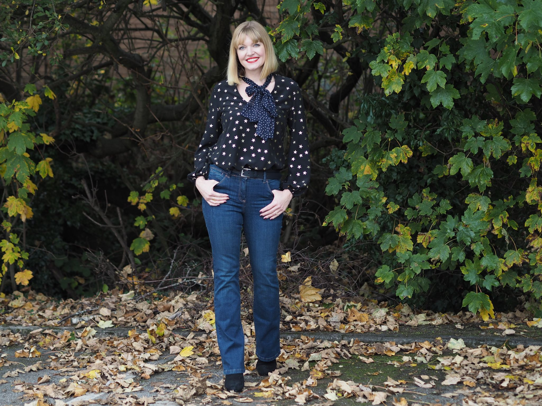 Rixo stars and dot blouse with bootcut jeans