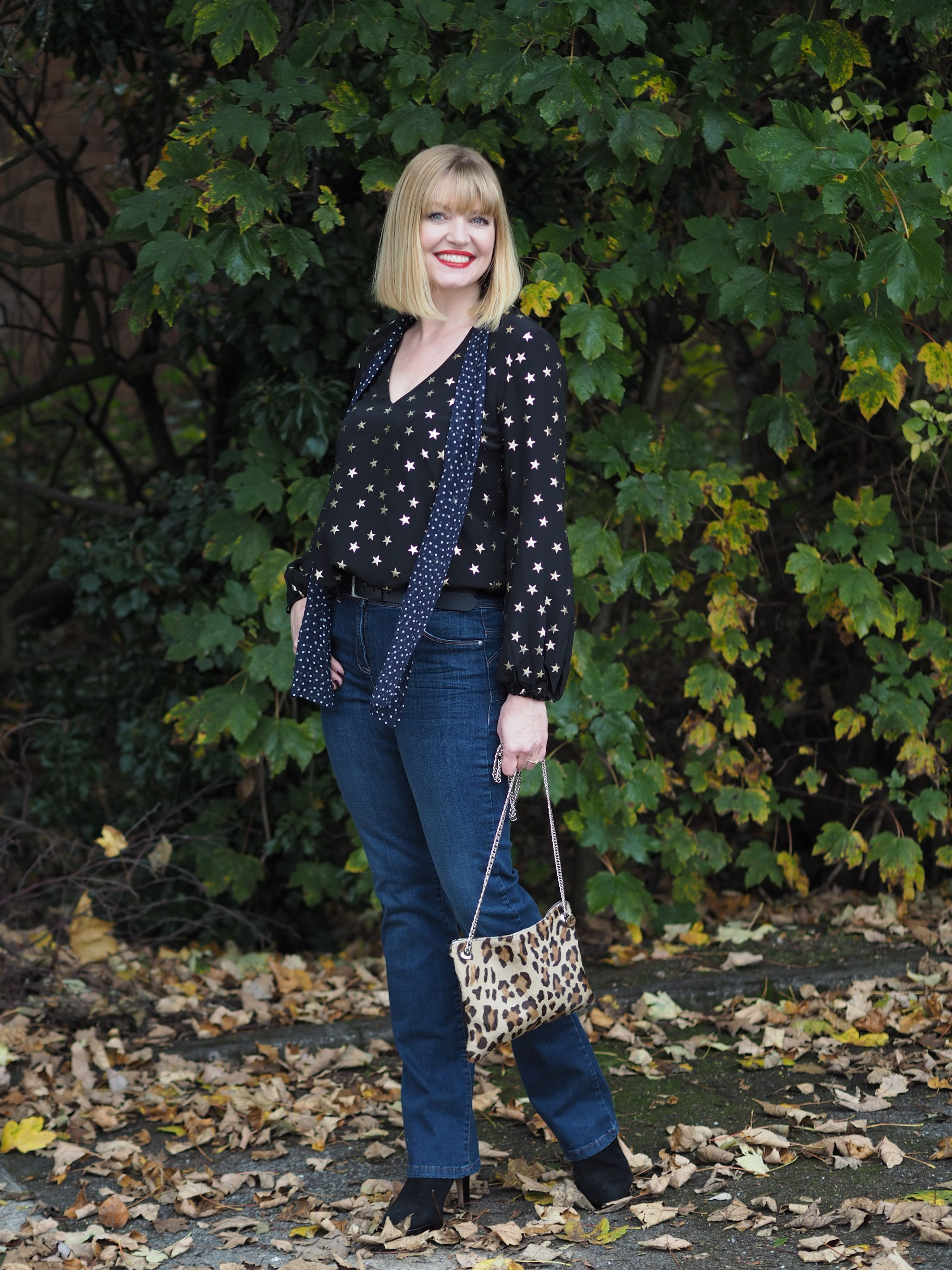 Rixo stars and dot blouse bootcut jeans leopard bag