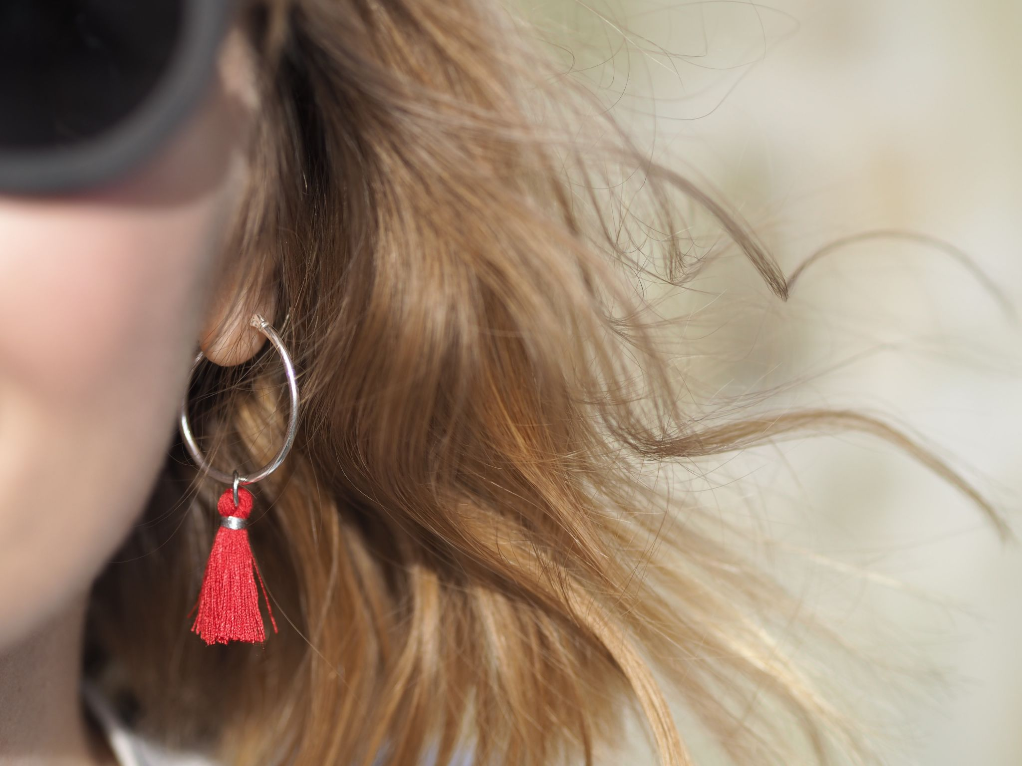 sustainable wooden round sunglasses and red tassel earrings