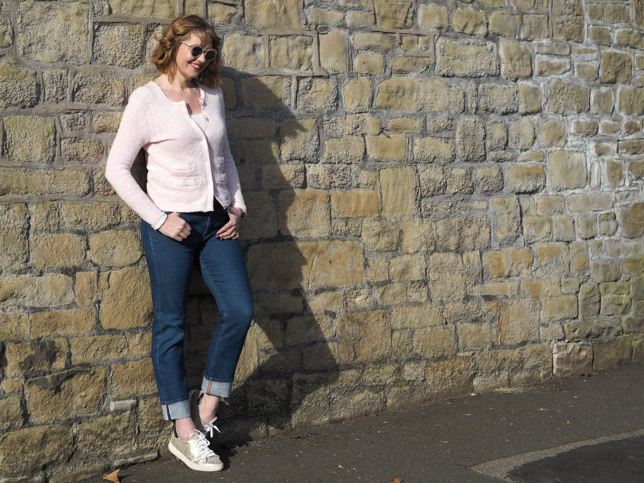 Pala Zola pink marble sunglasses with jeans and gold trainers
