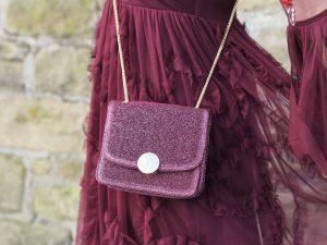 berry ruffled maxi dress and glittery bag