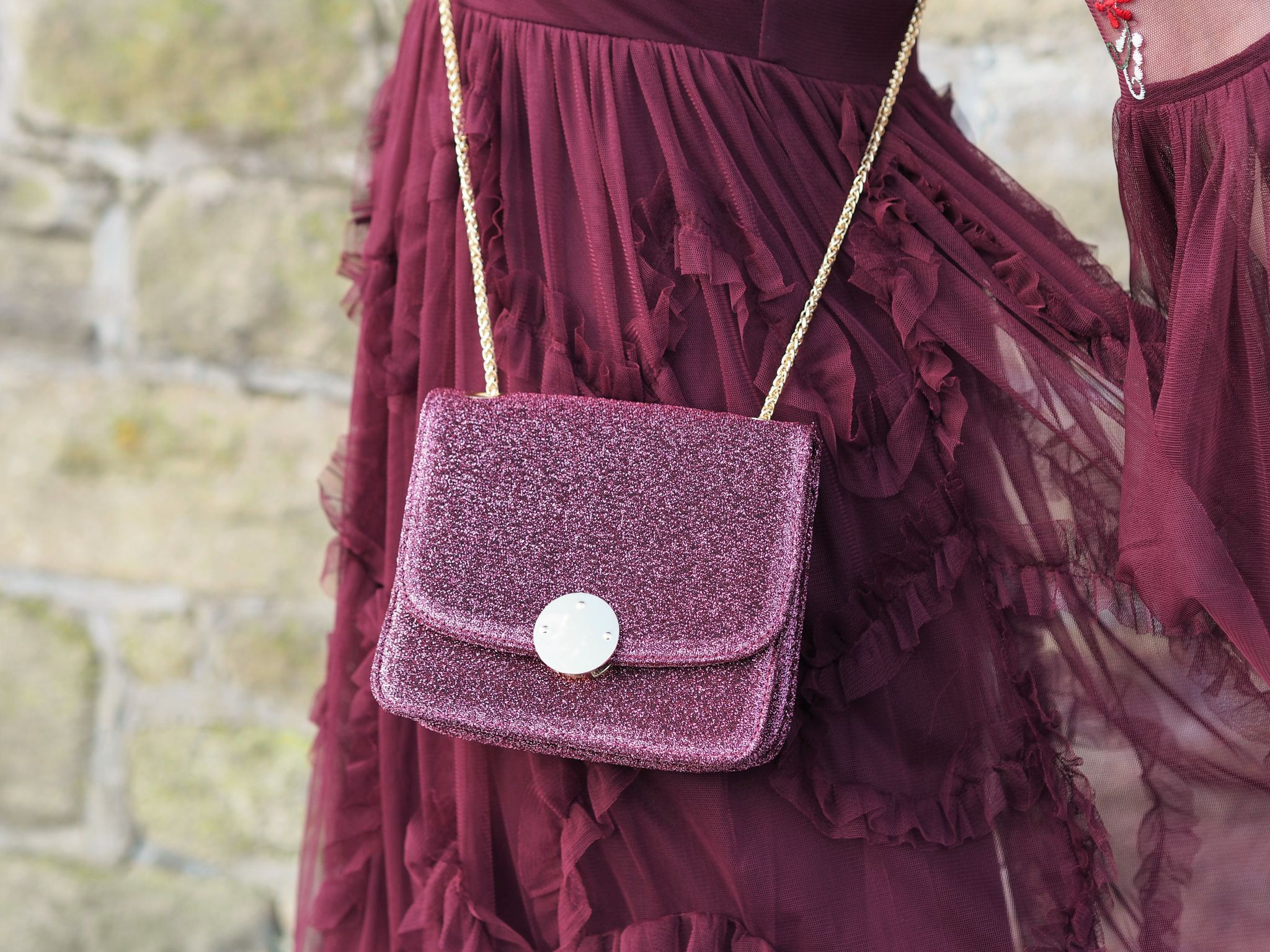 berry ruffled maxi dress and glittery bag