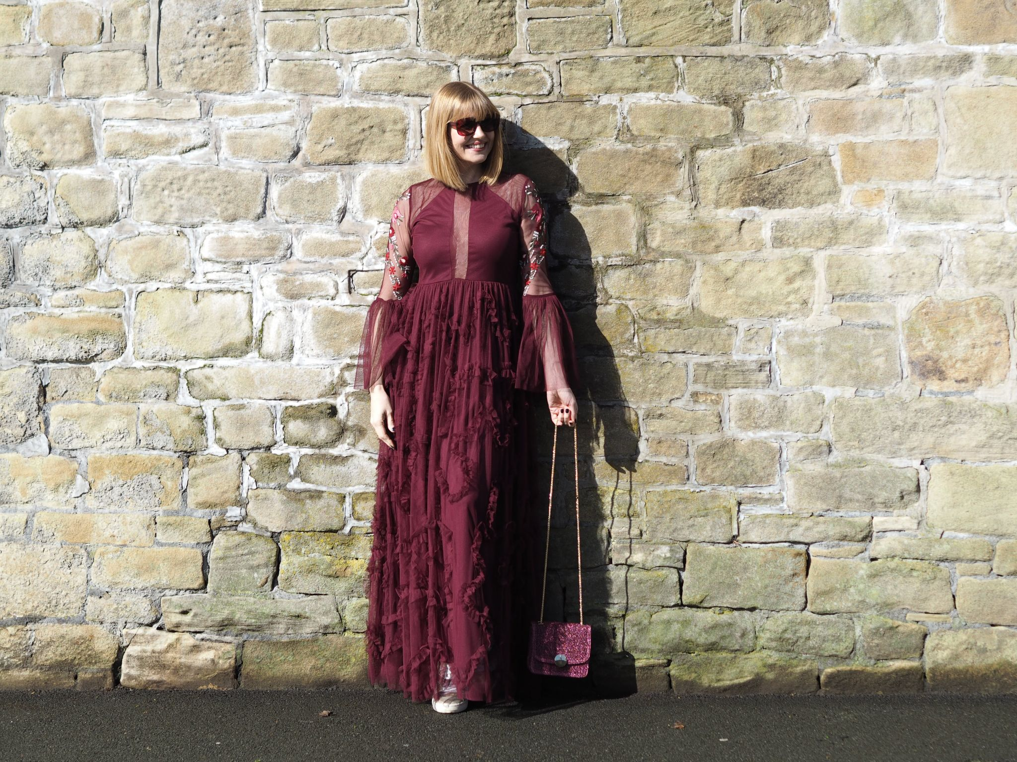 berry ruffled maxi dress and square sunglasses
