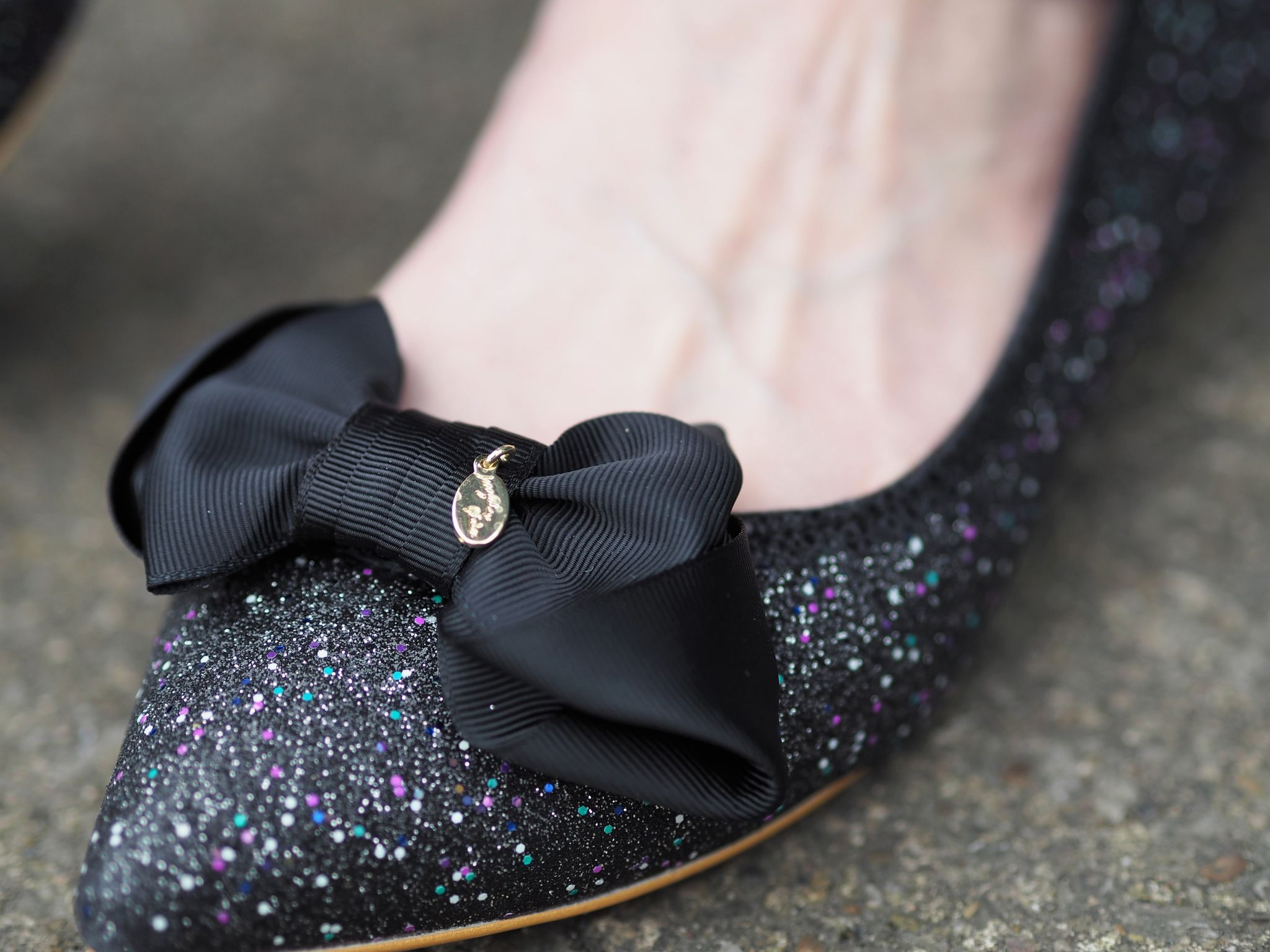 black multi coloured glitter ballerina shoes with bow
