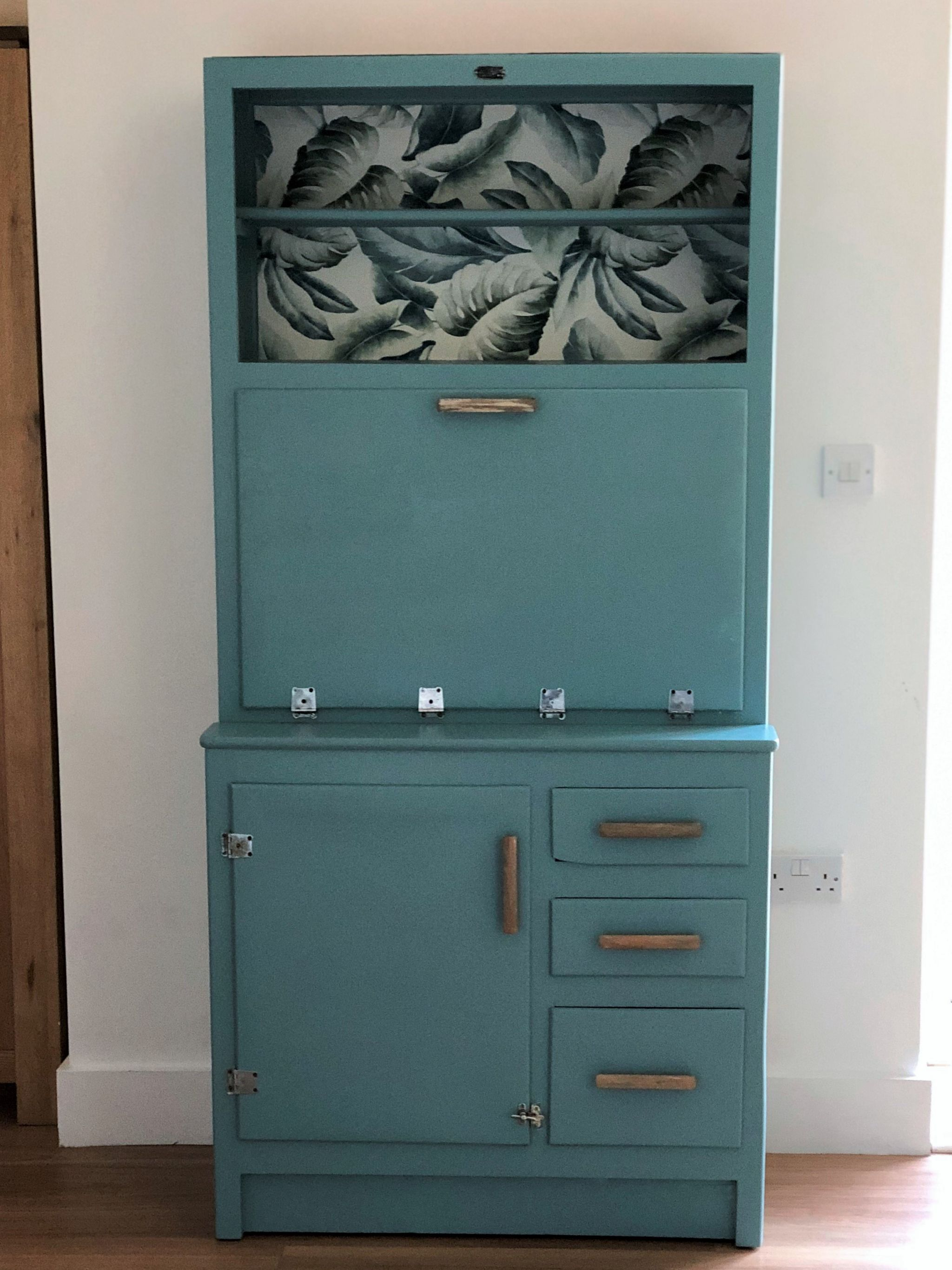 Cocktail cabinet makeover with monstera wallpaper