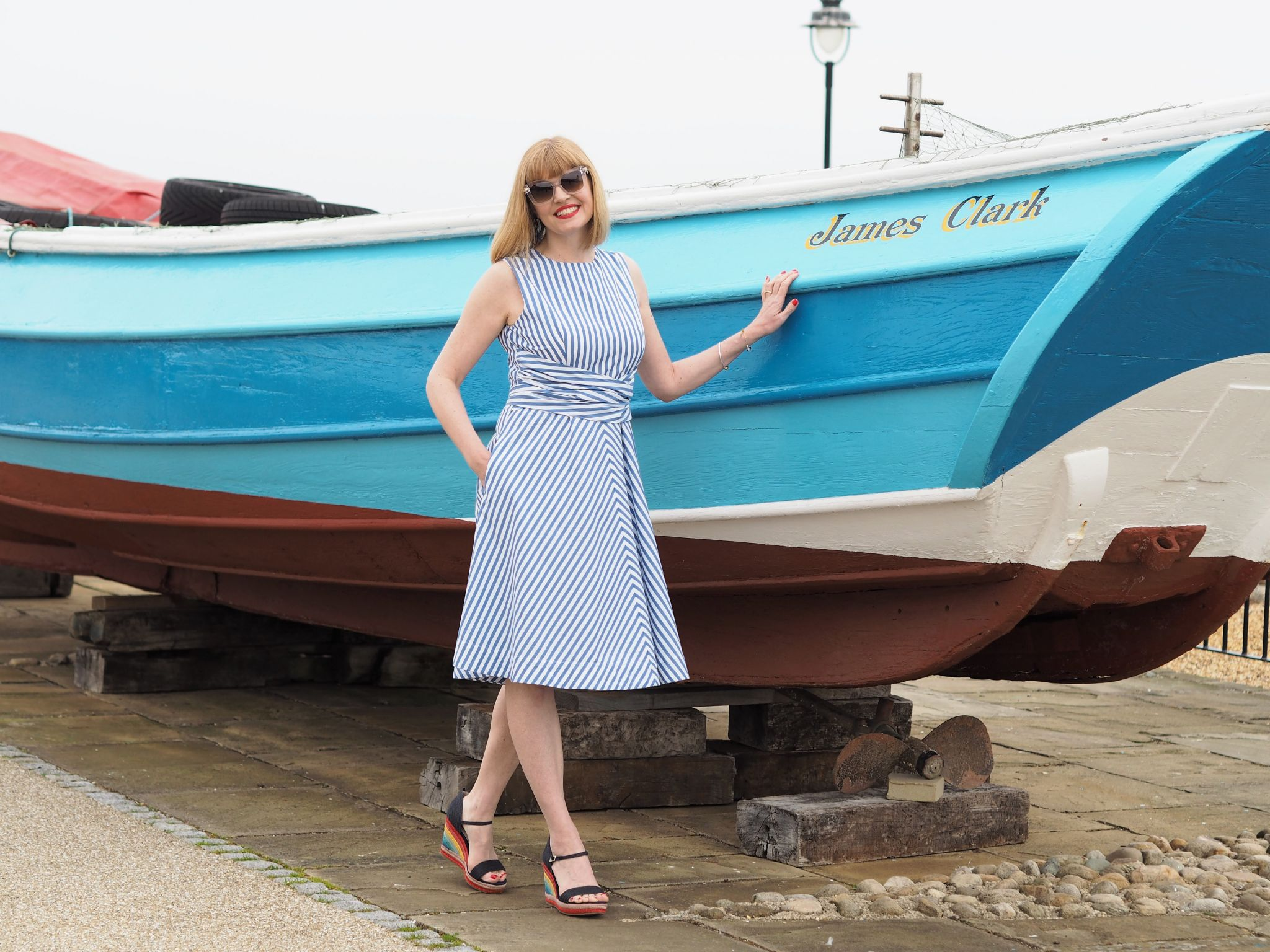Blue striped 1950s style dress and glamorous cat eye sunglasses