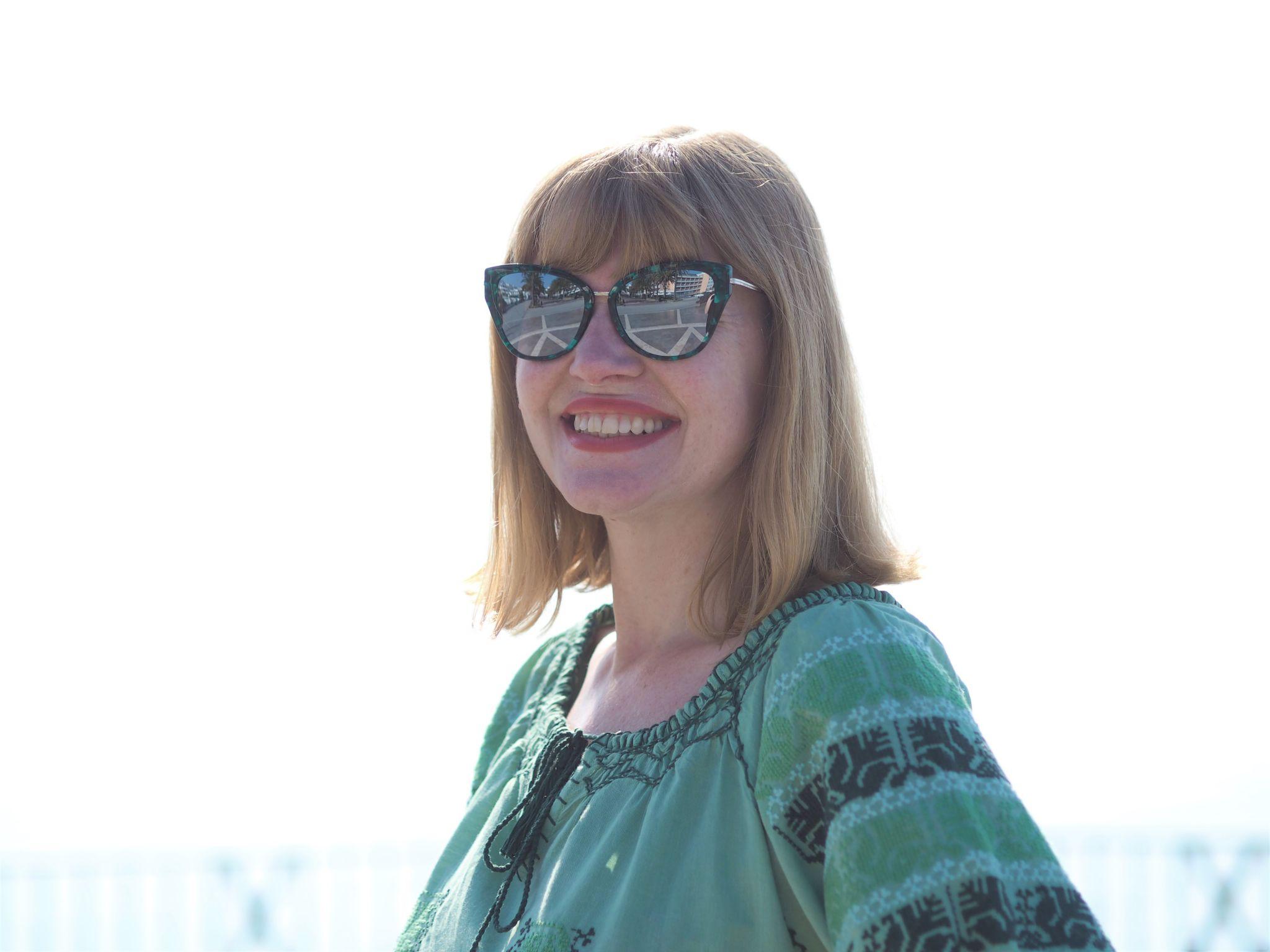 greem embroidered beach dress and green cat eye sunglasses