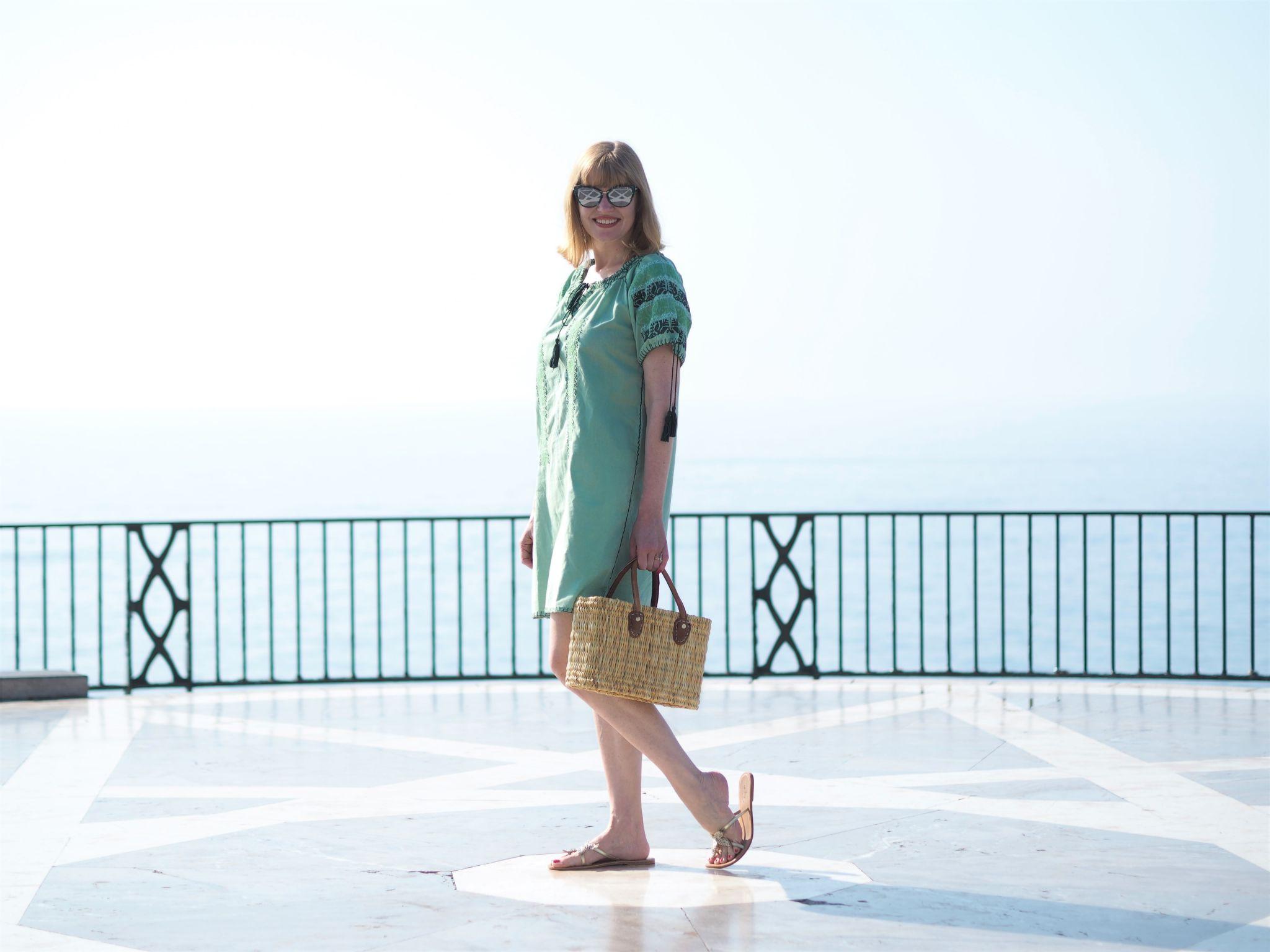 Green embroidered beach dress and green cat eye sunglasses el Balcon de Europa