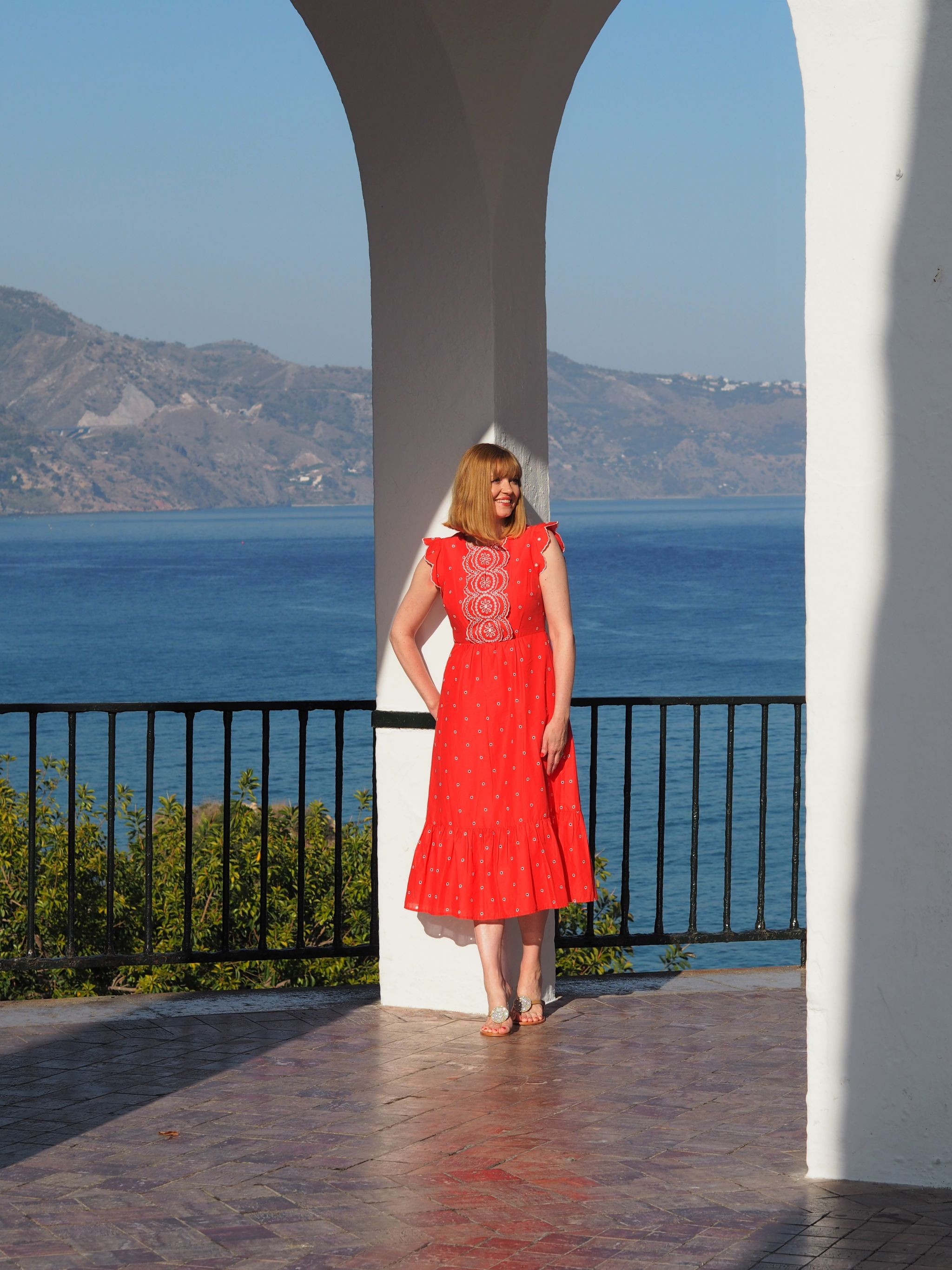 white archesBoden red broderie anglaise Lucinda dress in nerja