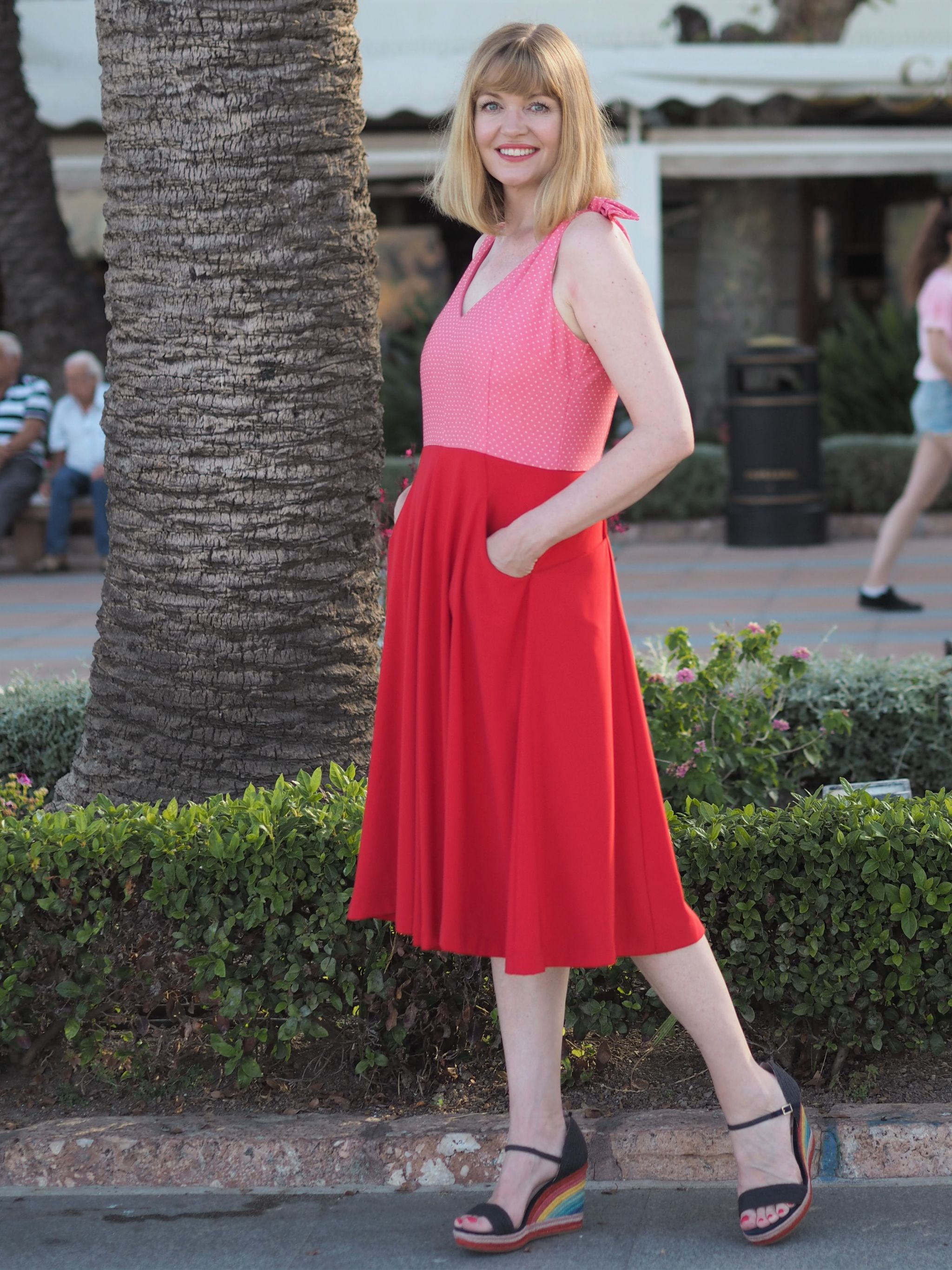 red and pink fifties style sundress with rainbow wedges