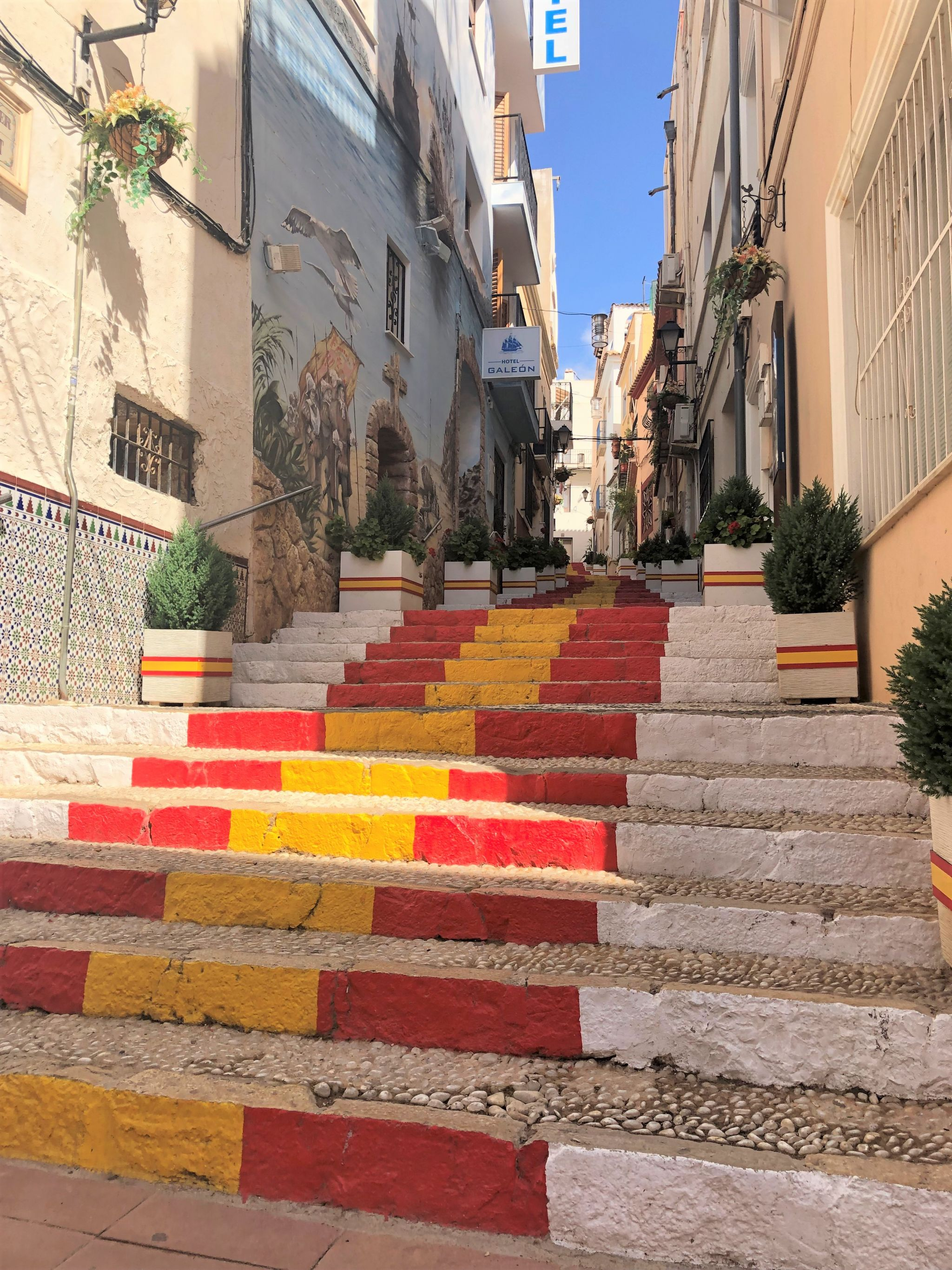yellow and red painted steps in Calpe