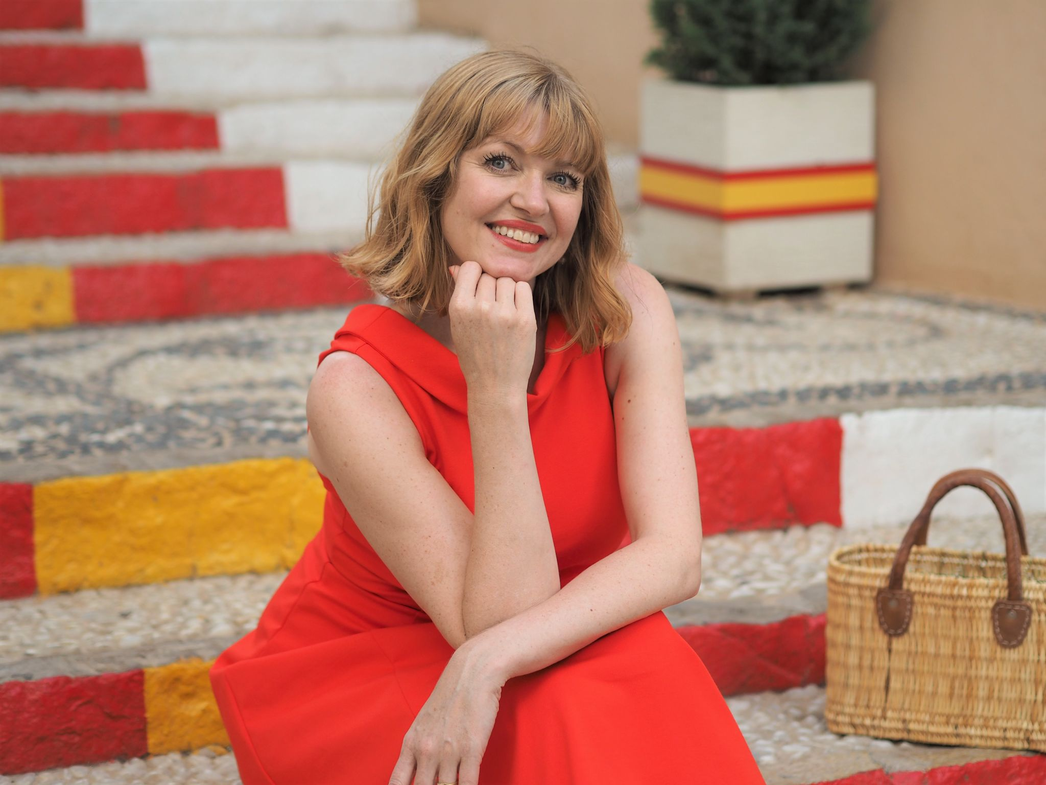 Red Boden Aria dress on yellow and red painted steps at Calpe